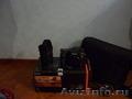 Продаю зеркальный фотоаппарат SONY